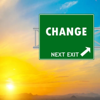 "A road sign that reads ""Change Next Exit"""